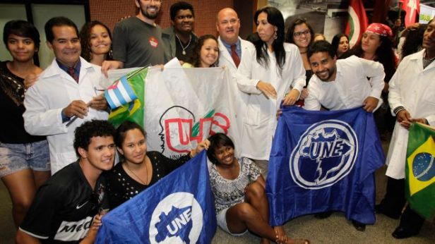 Cuban doctors pose for a photo with Brazilian students after their arrival at the International airport, in Brasilia, Brazil, Saturday, Aug. 24, 2013. More than 200 Cuban doctors have arrived in Brazil to work in impoverished areas where physicians and medical services are scarce in Latin America's biggest country, the Health Ministry said Saturday. (AP Photo/Eraldo Peres) Read more: http://latino.foxnews.com/latino/health/2013/08/25/over-200-cuban-doctors-arrive-to-help-brazils-poor/#ixzz2d56oNf6c