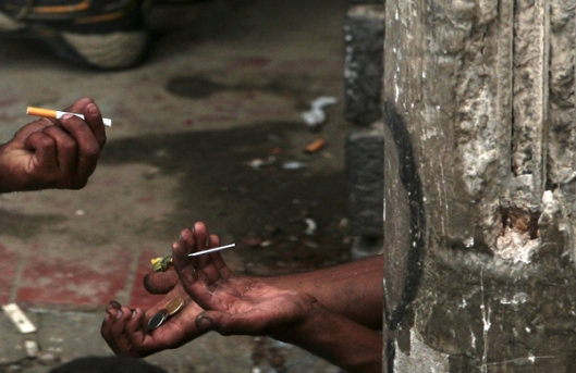 Drug users smoke crack in the part of Sao Paulo's Luz neighborhood known as Crackland