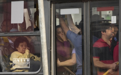 In this Aug. 9, 2013 photo, passengers sit and stand in a packed bus in Sao Paulo, Brazil. (AP Photo/Andre Penner)