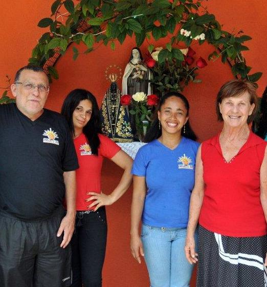 Luiz Carlos has been beside Sister Angela Mary every step of the way. Here they are with two former students, now active participants in the education of more youth.